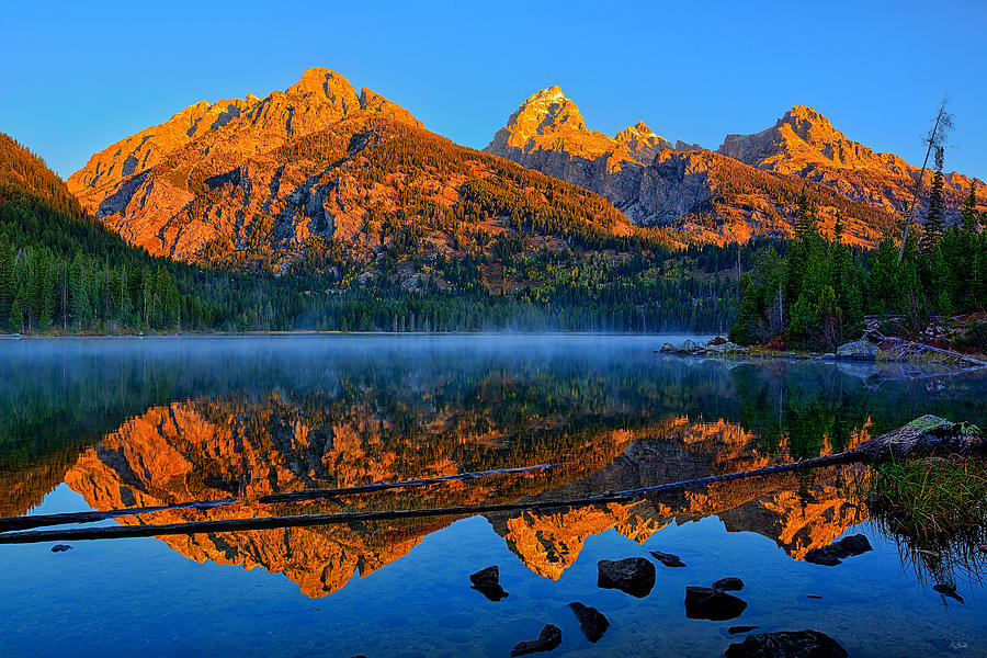 First light of the morning on the Tetons along Taggart Lake in Grand Teton National Park
