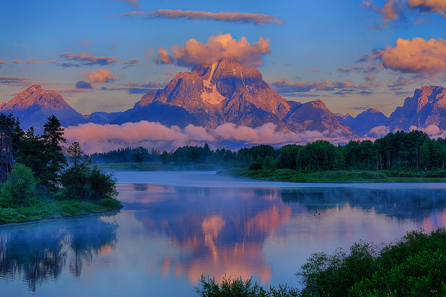 First light of the morning on Mt Moran and the Tetons at Oxbow Bend in Grand Teton National Park